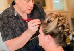 Brian Rice putting the final touches on an intricate updo.